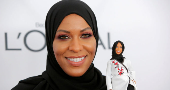 Olympic fencer Ibtihaj Muhammad holds a Barbie doll made in her likeness as she attends the 2017 Glamour Women of the Year Awards at the Kings Theater in Brooklyn, New York.